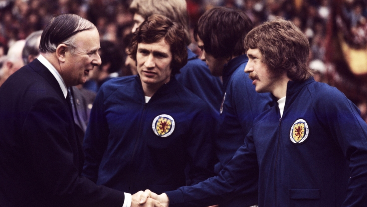 169472-scotland-captain-sandy-jardine-centre-introduces-team-mate-arthur-duncan-right-to-british-polici